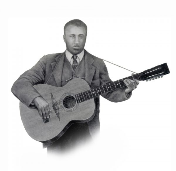 Blind Willie McTell playing guitar